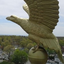 Main plaza historical eagle coated with gold paint